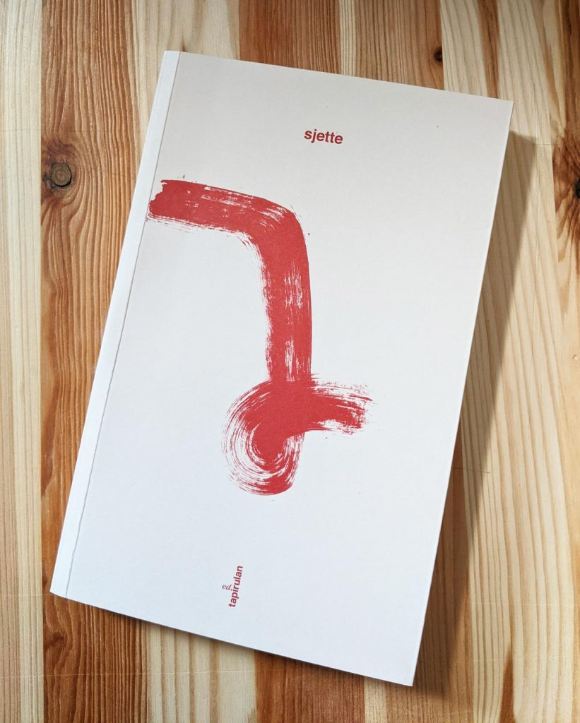 "Photography of the book's cover entitled ""Sjette""."